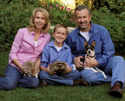 Ann, Phillip and Eric Huff with Russell the dog, Jeffrey the rabbit and Travis the tortoise