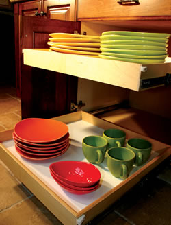 Custom roll-out shelves like these are hand crafted by Shelves to Drawers for your existing cabinets, creating easy access to those hard-to-reach places.
