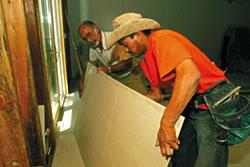 Myron Kalebjian checks on floor installation