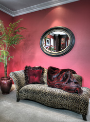 Chaise, throw, pillow and mirror selected from La Via Bella.