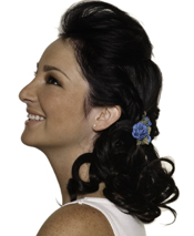 Twist the section of hair over the ears back and together into a loose, low bun on one side and curl the remaining strands. Nude lips let flirty eyes have the last word.