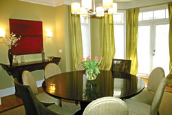 Dupioni silk in the same shade as the paint was used to create these simple, yet elegant, window treatments in this clean and contemporary dining room.