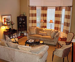 Alternating stripes of cream and taupe were used to create the window treatments.  Horizontal stripes were chosen over vertical stripes to make the traditional room a bit more casual.