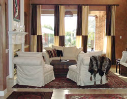 A collection of mismatched Persian carpets and chocolate hand-trowled plaster walls set the tone for Anne