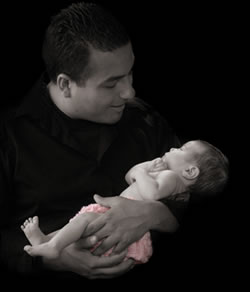 New dad Greg Corralejo with his daughter, Camryn.