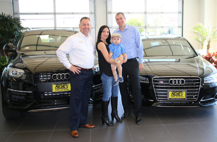 Mike and Kimberly Hrezo with baby Benjamin and  Audi Valencia General Manager Rob Smith.